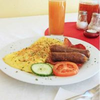 breakfast eggs sausage and tomato